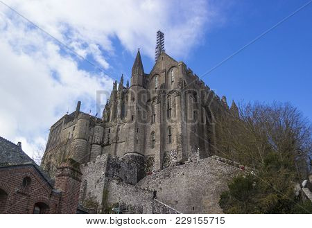 Mont Saint-michel, France - March 27, 2016: Mont Saint-michel View Of The Spire Of The Main Tower. R