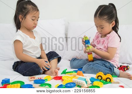 Concepts Of Learning Skills. Little Children Are Learning Skills To Play With Toys. Little Children