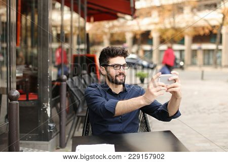 Happy Businessman Typing Message To Partner And Wondering With Successful Surprise In . Handsome Mal