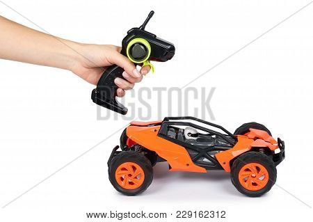 Rc Model Rally, Off Road Buggy With Remote Control In Hand. Isolated On White Background, Joy And Fu