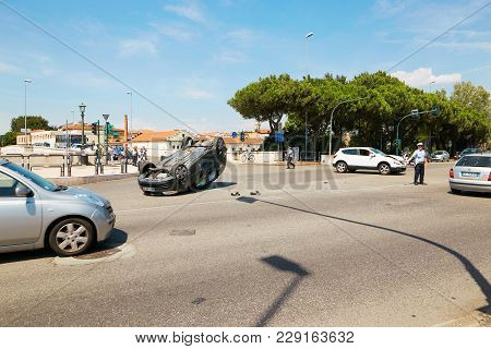 Verona, Italy - August 17, 2017: Auto Accident At The Crossroads Of Verona Streets. The Car Overturn