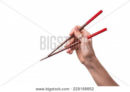 The Femail Hand Hilding Bringt Chop Sticks On Isolated White Background