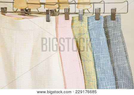 Collection Of Fashion Skirts On The Hanger. Clothing Store.