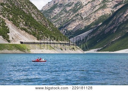Livigno, Italy - August 1: Woman With Boy Sailing On Pedal Boat On Lago Di Livigno On 1 August 2016