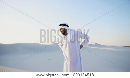 Frustrated Fellow Emirate Suffers From Back Pain And Holds On To Waist, Feels Heaviness And Tries To