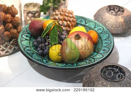 Green Oriental Plate With Fruits, Nuts In A Glass Bowl, Oriental Metal Lanterns