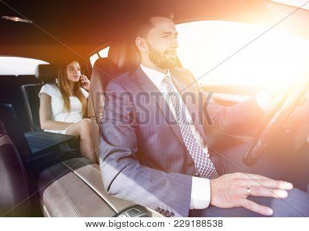 Portrait of a man driving a car
