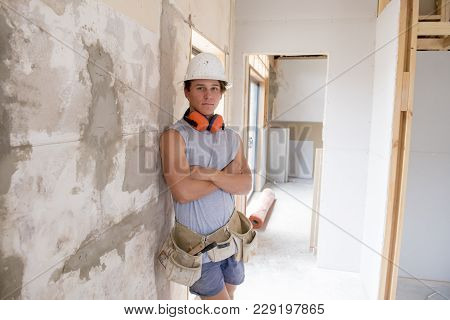 Young Attractive And Confident Builder And Constructor Job Trainee Learning And Working At Industria