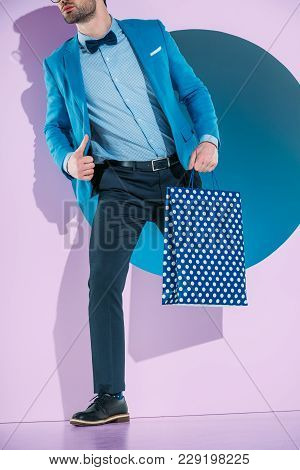 Cropped Image Of Man In Fashionable Clothes Going Through Purple Frame
