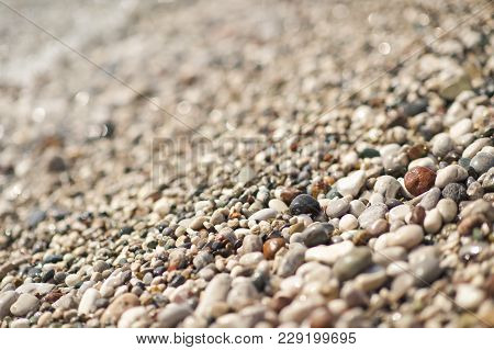 Photos Of Sea Pebbles With A Tidal Wave.