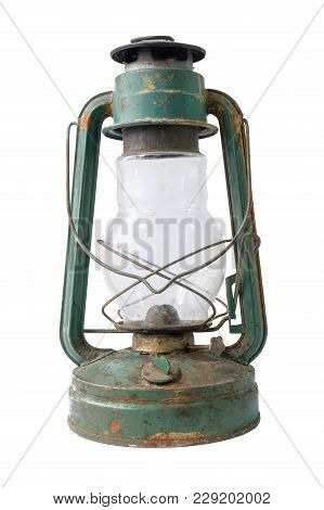 An Old Vintage Green Rustic Kerosene Lamp On A White Background, Isolated