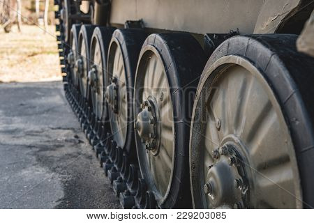 Caterpillar Of A Military Tank Standing In A Park.