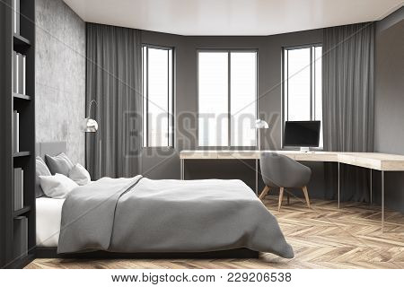 Modern Bedroom And Home Office Interior With Concrete And Gray Walls, A Wooden Floor, A Master Bed A