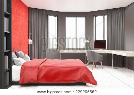 Modern Bedroom And Home Office Interior With Red And Gray Walls, A Concrete Floor, A Master Bed And