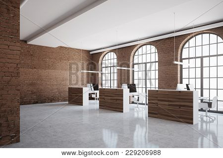Brick Open Space Office Corner With Arch Windows, A Concrete Floor And Cubicles. 3d Rendering Mock U