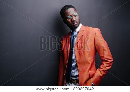 Stylish Black American Man In Suit With Glasses. Fashion Studio Shot.