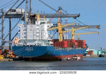 Antwerp, Belgium - Jul 9, 2013: Container Ships Moored At A Independent Maritime Terminal In The Por