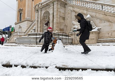 Snow Covers The Streets Of Rome, Italy. Snow Games In Piazza Del Campidoglio.