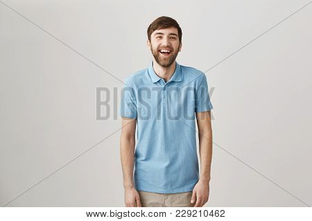 Sense Of Humour Makes Man Unique. Portrait Of Slender Ordinary Caucasian Guy With Beard And Moustach