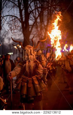 Pernik, Bulgaria - January 26, 2018: Man Dressed In Scary Kuker Fur Costume And Mask With Horns And