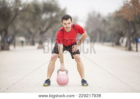 Man Training With The Kettle Bell Low Position