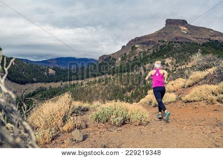 Trail Running Girl In Mountains On Rocky Path. Cross Country Runner Training In Inspiring Nature, Di
