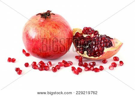 Ripe Pomegranate Fruit And Its Half With Seeds On White Background. Vegetarian Concept, Organic Vita