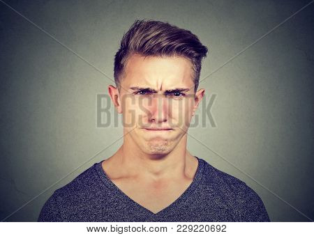 Young Man Full Of Hatred Looking Pissed Off And Annoyed Squinting Eyes And Frowning