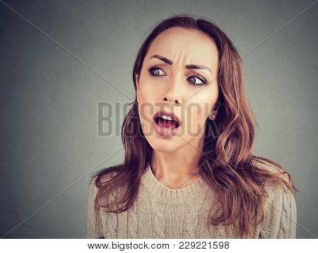 Young Amazed Woman In Casual Outfit Looking Away Excited With Gossip.