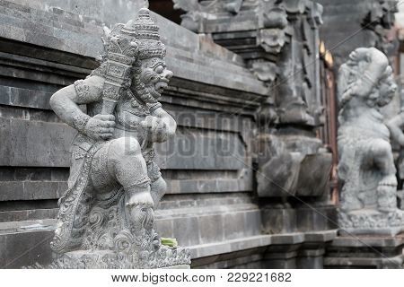 Bali, Indonesia - December 13, 2017: A Carved Statue With Fine Details Stand Outside The Entrance To