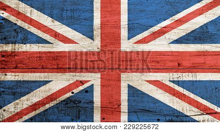 Old Grunge Vintage Uk Great Britain National Flag Over Background Of White Painted Wooden Planks Boa