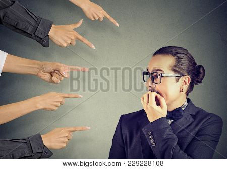Anxious Man Scared Of Being Judged By Different People. Concept Of Accusation Of Guilty Guy. Negativ