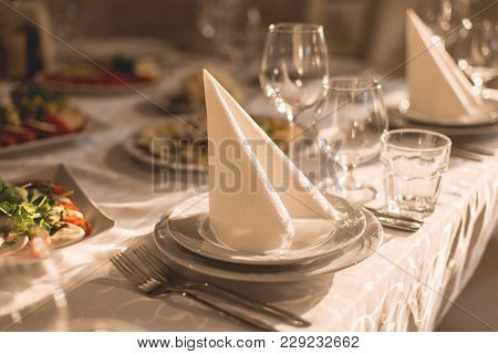 Banquet Hall Of The Restaurant, Beautifully Decorated Tables With Food