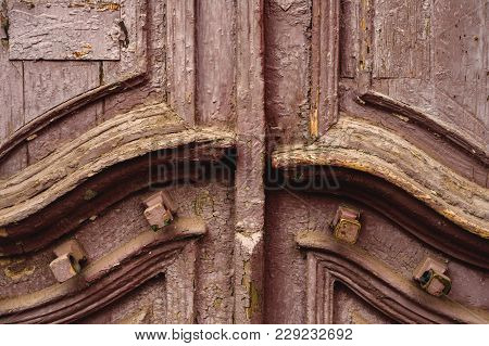 Close-up Wooden Ancient Italian Door In The Historic Center. Old European Architecture. Two-fold Woo