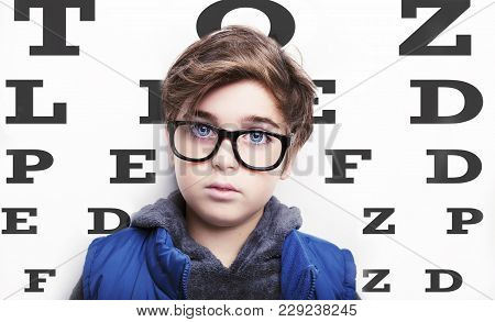 Handsome Boy Is Wearing Eyeglasses On White Background.