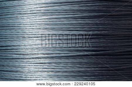 Beautiful Metallic Background, Texture Of Rope. Steel Or Metal Rope, Wire. Building Material Concept