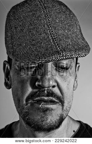 Portrait Of Man With Cap In B & W