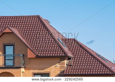 Multilevel Roof With Under Balcony Attic Skylights, Snow Guards, Rain Gutter