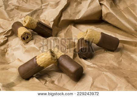 Sweet Wafer With Dark Chocolate On The Paper Bag