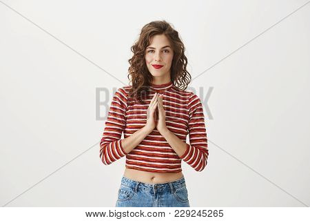 I Have Great Plan And Going To Fulfill It. Portrait Of Intrigued Attractive Woman Smiling Mysterious