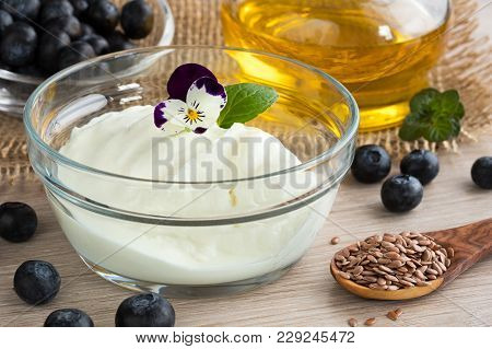 Cottage Cheese With Flax Seed Oil, Blueberries, Flax Seeds And Edible Flowers