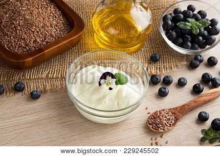 Cottage Cheese With Flax Seed Oil, Blueberries, Flax Seeds And Edible Flowers, With Copy Space