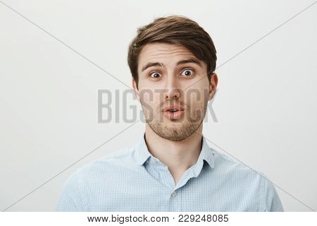 Guy Is Startled And Stunned Of Seeing Someone Very Ugly. Portrait Of Shocked And Confused Handsome M