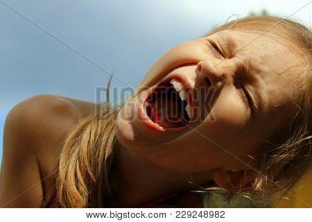 Children,people,emotions Concept.cropped Shot Of A Screaming Girl.close Up Portrait Of A Crying Girl