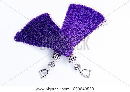 Purple Handmade Earrings On White