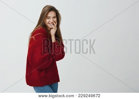 Girl Likes To Get Attention. Portrait Of Emotive Good-looking Female In Loose Red Sweater, Laughing