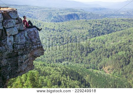 Young Man Hiker Sitting On Top Of A Mountain On On High Altitude And Enjoy Amazing View. - Wide Shoo