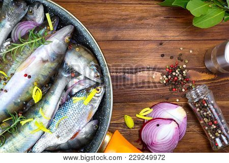 Fresh Fish Top View. Spicy Herb And Vegetables. Fish And Spices On A Metal Table. Healthy Food Cooki