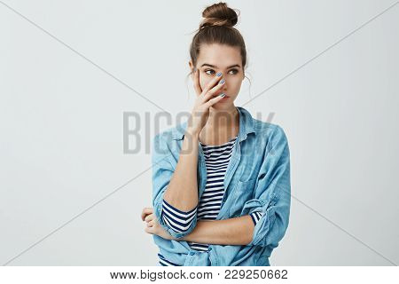 You Embarrassed Me In Front Of Friends. Portrait Of Irritated Young European Woman In Bun Hairstyle