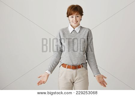 Woman Did Not Have Answer On Question. Studio Shot Of Attractive Short-haired Redhead Female Student